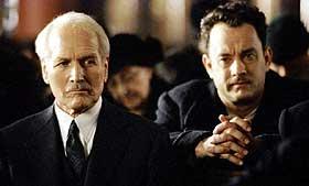 FEDRE OG FIENDER: De var som far og sønn. I «Veien til fortapelse» slåss de etter hvert begge for å redde hvert sitt barn. Paul Newman som John Rooney og Tom Hanks som Michael Sullivan.