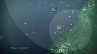 UNDER PASSERING: Som vist dekker overv�kningsradiusen til den norske satellitten et mye st�rre omr�de enn bakkestasjonen. Illustrasjon: Seatex/Kystverket/FFI/Norsk Romsenter