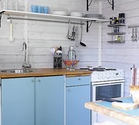 Grønn kjøkkeninnredning