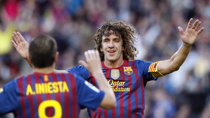 FOKUS P BARCA:  Carles Puyol gir seg p landslaget for  konsentrere seg om  prestere p Barcelona .Foto: REUTERS/Albert Gea