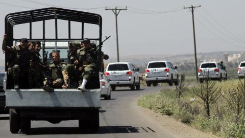 SKADET:  Et syrisk milit�rt kj�ret�y ble truffet da en veibombe eksploderte. Foto: AFP PHOTO/LOUAI BESHARA