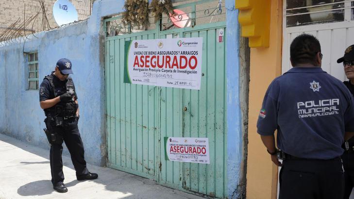 HUSET: Politiet har forseglet huset der gutten ble funnet. Foto: REUTERS/Alejandro Dias/NTBScanpix