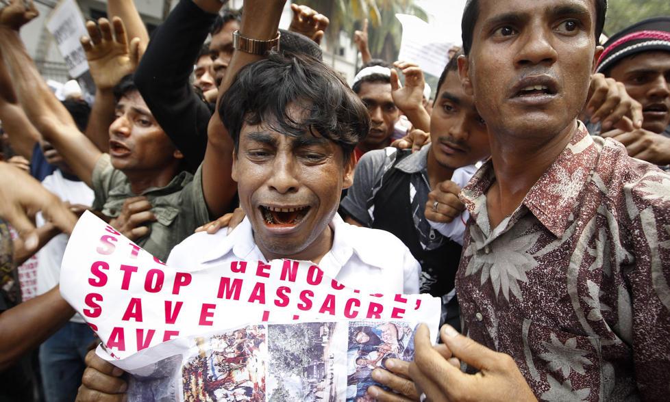STANS MASSAKRENE: Rohingyaer i Malaysia demonstrerer mot drap av muslimske rohingyaer i buddhistiske Burma. Foto: AP/Scanpix