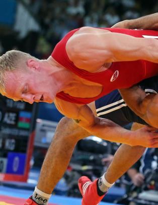 Berge kjempet mot t�rene etter OL-tap