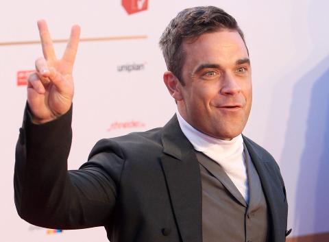 �Candy�: Robbie Williams kommer mot slutten av �ret med et nytt album. P� albumets f�rste singel har han spilt inn store deler av ei l�t av norske Todd Terje p� nytt. Foto: NTB Scanpix