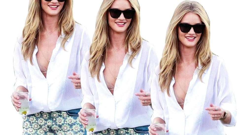 I BLUSE: Rosie Huntington-Whiteley styler blusen med kule, korte shorts med broderier. Foto: Stella