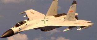 Kinesisk jagerfly fl�y seks meter unna amerikansk marinefly