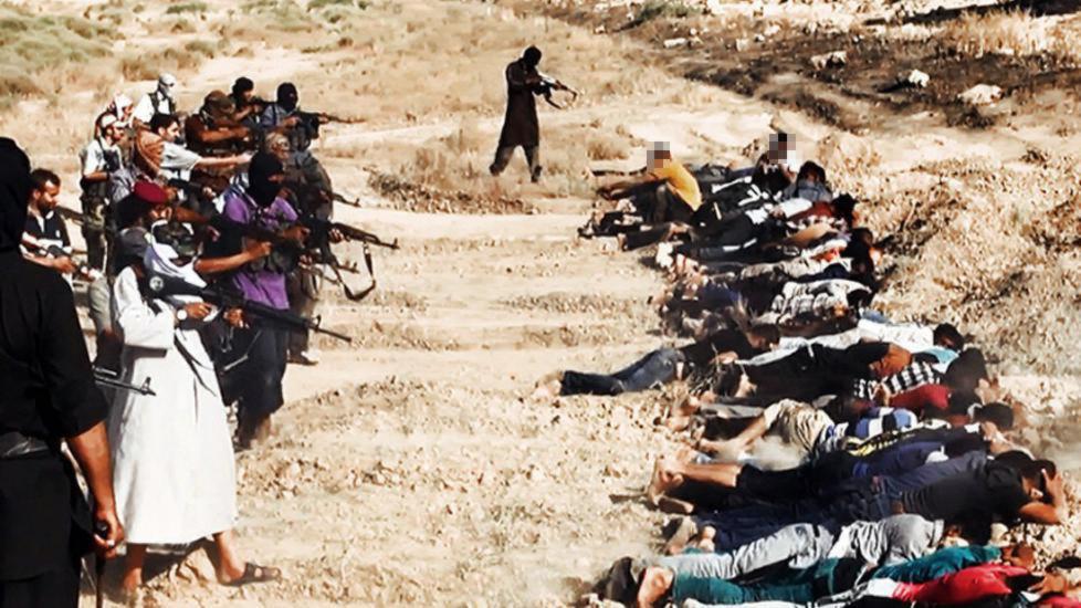 BRUTAL FRAMFERD: Bildet er grabbet fra en video der IS viser massehenrettelser av irakere if�rt sivile kl�r. Foto: NTB scanpix