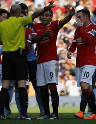 Her mener Rooney dommeren gj�r rett