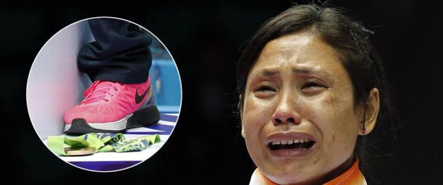 Hun la igjen medaljen p� pallen og stormet ut, oppl�st i t�rer