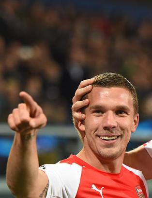 Podolski reddet 65-�rsdagen til Wenger