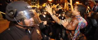 - Ferguson-oppt�yene og m�ten mediene dekker det, viser hvor polarisert USA er