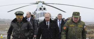Rubelen ligger med brukket rygg, men Putin hevder det aldri vil g� ut over den milit�re opprustningen