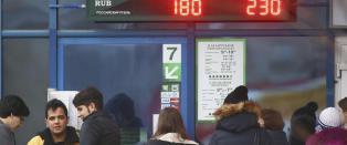 Hviterussere panikkj�pte utenlandsk valuta - frykter russisk �konomi-kaos