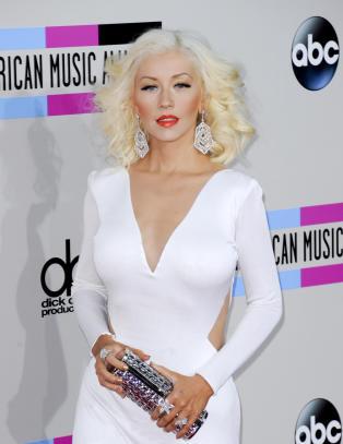 Christina Aguilera viser fram dattera for f�rste gang