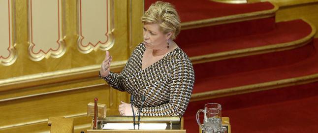 Siv Jensens ulike kjolar og roller: Leppestiftar som partileiar og kaffib�nner som statsr�d