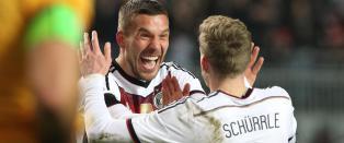 Podolski reddet verdensmesterne fra sjokktap