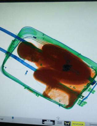 Faren: - Ante ikke at s�nnen befant seg i kofferten