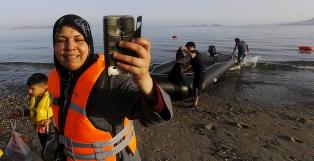 Her ankommer et hundretalls flyktninger den greske ferie�ya Kos