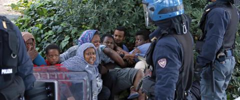 EU-landene er enige om � ta over 40 000 flyktninger fra Italia og Hellas