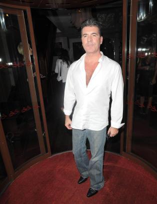 Simon Cowell �knust� etter moras d�dsfall - har avlyst �X Factor�-innspilling p� ubestemt tid