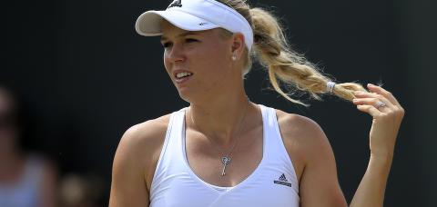 F�rst r�k hun ut av Wimbledon. S� ble hun servert et pinlig sp�rm�l om eksen. Svarte med stillhet og stirring