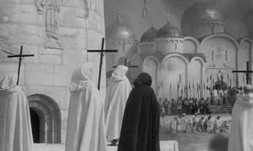 DE KJEMPET FOR KORSET: Korstogenes religi�se ridderordener brorskap av elitekrigere. Tempelherrene, den f�rste ordenen, var effektive og disiplinerte, og ble ogs� beundret av b�de fiender og venner. De oppsto i 1120 under ledelse av Hugo av Payn. Bildet er fra en film fra 1937. Riddere forbereder en henrettelse i 1240. Foto: WIKIMEDIA
