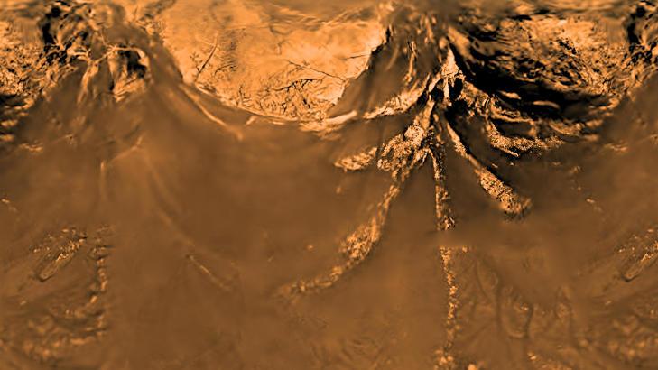 PLASK: Titan er den eneste kloden utenom Jorda hvor det er påvist innsjøer på overflaten, her i form av flytende metan. Også her spekuleres det i om liv kan ha oppstått. Dette bildet av overflaten ble tatt av Huygens-sonden som dalte ned til månen i 2005. Foto: NASA/SCANPIX