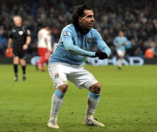 HAR NETTET 15 GANGER: Carlos Tevez er blitt en kjempesuksess i Manchester City etter overgangen fra United. Foto: AFP/ANDREW YATES